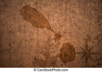 saint kitts and nevis map on a old vintage crack paper background
