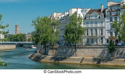 Saint-Louis bridge timelapse with houses on Orleans...