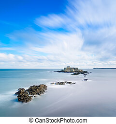 Saint Malo beach, Fort National and rocks during High Tide. Brittany, France, Europe. Long exposure photography
