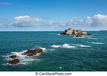 Tidal island in front of Saint Malo, Brittany (France) during high tide. High quality photo