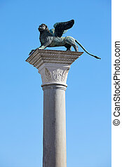 Saint Mark winged Lion statue on column, symbol of Venice in Italy