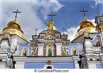 Saint Michael Monastery Cathedral Steeples Spires Facade Kiev Ukraine. Saint Michael's is a functioning Greek Orthordox Monasatery in Kiev. The original monastery was created in the 1100s but was destroyed by the Soviet Union in the 1930s. St. Michaels was reconstructed after Ukrainian ...