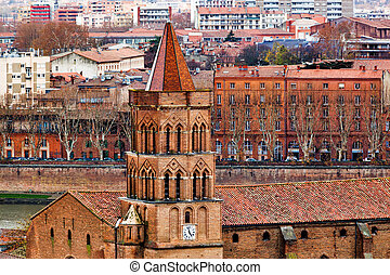 Saint Nicolas church on Toulouse background