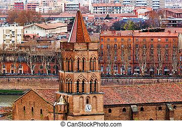 Saint Nicolas church on Toulouse background