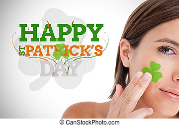 Saint patricks day greeting with smiling woman with shamrock...