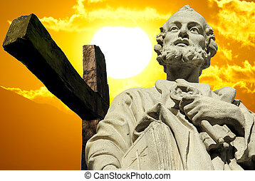 saint peter and cross on sunset background