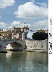 A view of the cathedral of Saint Peter in Vatican, seen from the Tiber, the river that crosses Rome