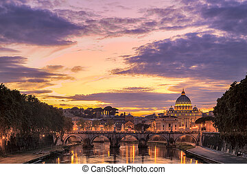 Saint Peter's basilica at sunset with the Ponte Sant'Angelo in the foreground