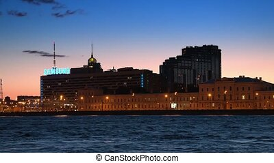 SAINT-PETERSBURG, RUSSIA - JULY 07, 2015: The residential complex AURORA and the SAINT-PETERSBURG hotel at the Pirogov embankment,night view
