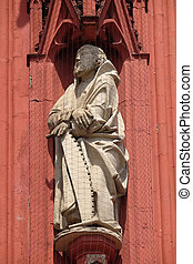 Saint Simon the Apostle statue on the portal of the Marienkapelle in Wurzburg, Bavaria, Germany