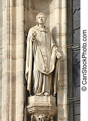 Saint Stephen, the martyr (or protomartyr - the first of martyrs). One of statues in the Cathedral of Milan (Italy).