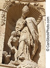 Valencia, Spain. Architecture detail of famous Cathedral - statue of Saint Thomas of Vilanova.