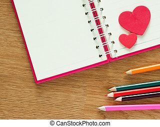 saint-valentin, fond, à, rouges, cœurs, livre, pour, agenda, et, couleur, crayons, sur, bois, floor., amour, et, valentin, concept.