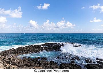 Sainte-Anne, Martinique, FWI - Waves in the blue eye hole (oeil bleu) in Ferr? Cape