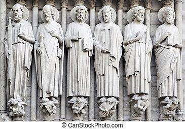 Saints on fasade of The Notre Dame de Paris. France.