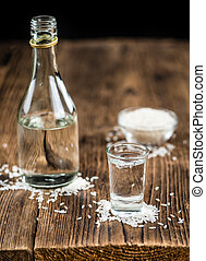 Sake (Japanese drink) on an old wooden table