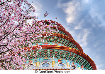 sakura - Sakura flowers and pagoda on blue sky in day.