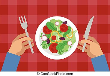 Salad and hands holding knife and fork