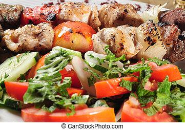 Salad and shish kebab