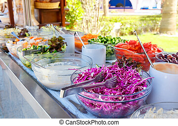 Salad buffet. The people themselves impose the desired...