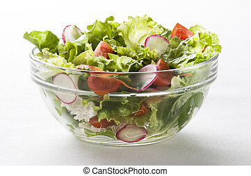 Fresh green salad with tomato close up shoot