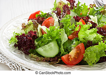 Salad - Fresh salad with green, red lettuce, tomato and ...