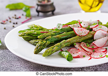 Salad from asparagus with radish and chard. Vegan cuisine....