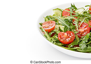 salad from ruccola, cherry tomatoes and cucumber, on white...