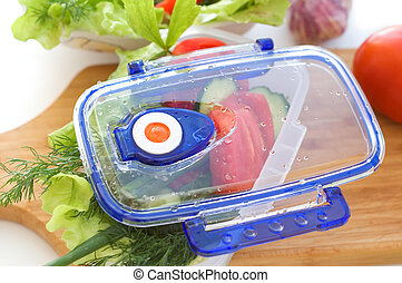 Salad from vegetables in the container.