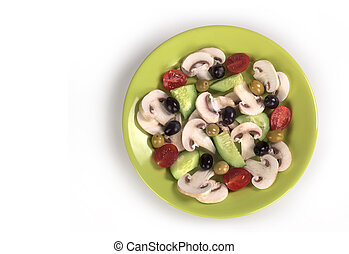 Salad in a light green plate on a white background