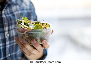 salad in a plastic box
