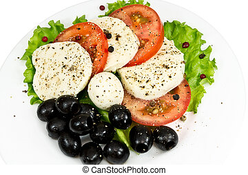 salad in a plate of mozzarella, tomatoes, olives and seasoning