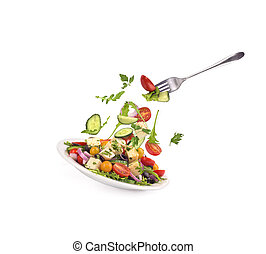 Salad in a plate on a white background