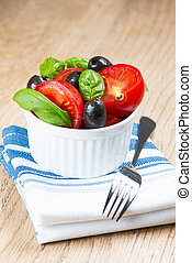 Salad in bowl on wooden table