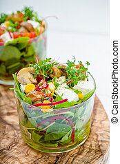 Salad in glass with pickled mushrooms