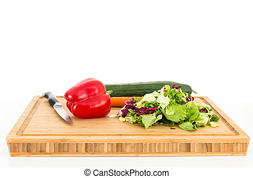 Salad ingredients on a cutting board
