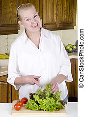 salad is prepared from a housewife in her 50s