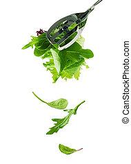 Salad leaves - Fresh salad leaves fall down.