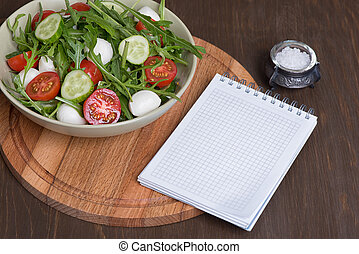 salad made with arugula, tomatoes, mozzarella