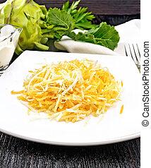 Salad of carrot and kohlrabi on board