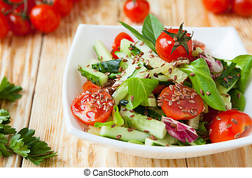 salad of cucumbers and tomatoes on a wooden table