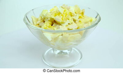 Salad of eggs, orange, chicken, cheese, standing