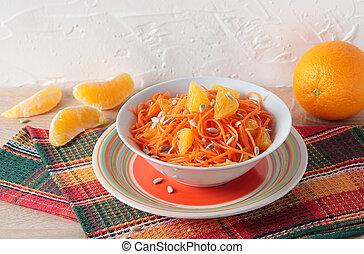 Salad of fresh carrots with orange slices