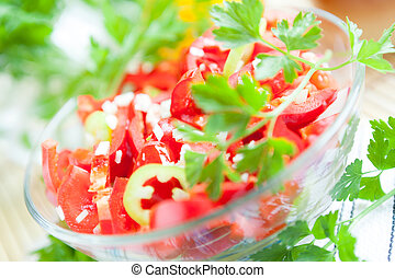 Salad of fresh red pepper in a glass bowl