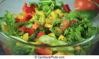 Salad of fresh vegetables rotate in a circle