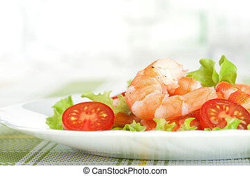 Salad of king prawns and vegetables on a plate