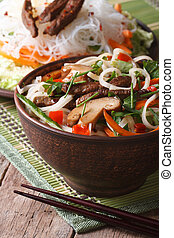 Salad of rice noodles with meat, shiitake and vegetables...