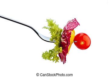 salad on a fork - salad and vegetables on a fork. healthy...
