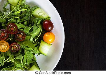 Salad plate on dark.