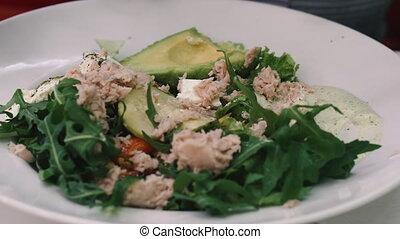 Salad. Seafood salad. Woman eating salad.